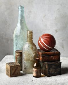 Still life with old bottles, tins, and bocce ball. Narrative Photography, Object Photography, Fruit Photography, Still Life Photography, Vintage Photography, Photography Poses, Still Life Pencil Shading, Still Life Drawing, Still Life Art