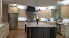 """Stunning! Sophisticated """"Farmhouse chic""""was the design for these new homeowners. White Shaker cabinets, white subway tile contrasted by dark charcoal grey custom hood and enormous Center Island."""