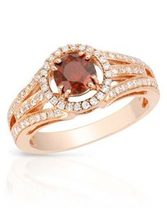 Fancy dark red enhanced diamonds in 14K rose gold.
