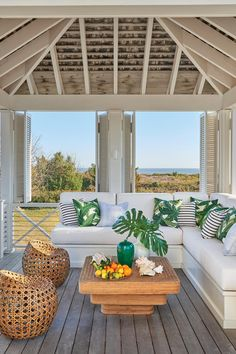 Breezy Outdoor Retreat | A pair of Manhattanites find refuge on the mellow Carolina coast. And their elegant design leanings? They came, too – with an island spin. Originally appeared on Coastal Living