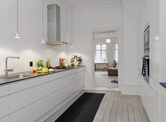 Scandinavian Kitchen Design to Spice your Dine : Decorative Lamps And White Walls