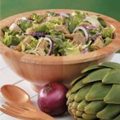 Tossed Salad with Artichokes Recipe -This is a wonderful salad recipes that I acquired from a friend. It's quick and easy to prepare, and is always a hit with my family and guests.