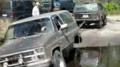 Jeep pulling truck