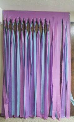 Loved these ruffled streamers made from simple $1 plastic party tablecloths via Cupcakes and Cutlery....