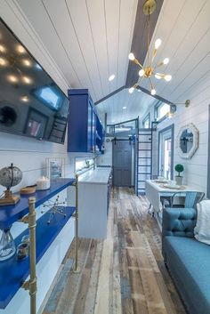 The Henderson: an eye-catching 330 sq ft tiny house from Moveable Roots with two bedrooms, including one on the ground floor!