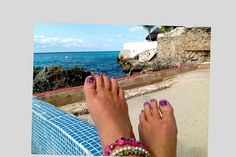 My pedicure for the week. 11/4/12. Zoya Melia polish base that my sweet next door neighbor Maria loaned to me. I made the flowers with a dotting tool using an OPI pink and white and a Piggy Polish Green. Photo taken next door at Villa Loyd, Cozumel, Mexico.