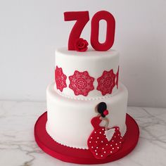Flamenco inspired 70th birthday cake: red, white, dancer, edible lace