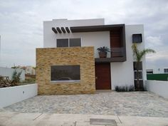 Fachada : Casas modernas de SANTIAGO PARDO ARQUITECTO