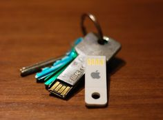 i love the little macbook usb drive--it's got a hole to fit on a keychain but it's smaller than the truly key-shaped usb drives
