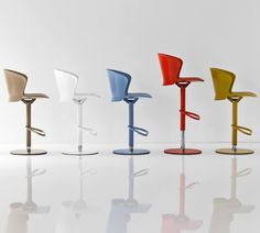 The name 'Bahia' refers to exotic landscapes while the shape resembles large petals from tropical flowers. This cheerful, contemporary and functional Calligaris bar stool has a gas lift mechanism and a 360 degree swivel making it perfect for open planned spaces. <br /> The curved, ergonomic seat and contoured footrest ensure you have maximum comfort at all times.<br /> <br /> Available with a metal stem painted in a variety of colours with a matching coloured seat.