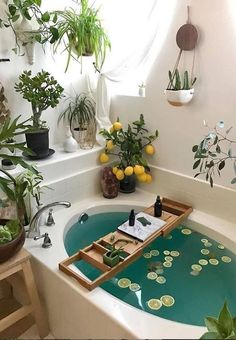 This bohemian bathroom is vivid and vibrant, the usage of the curtain set and th. This bohemian bathroom is vivid and vibrant, the usage of the curtain set and the rug as nicely as Bohemian Bathroom, Cozy Bathroom, Bohemian Decor, Bohemian Style, Bathroom Plants, Bohemian Bedroom Design, Garden Bathroom, Bohemian House, Bathroom Inspo
