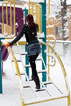 You're never too old for playgrounds-until you get stuck...Good thing the snow and ice in winter help move you along!  Behind the Scenes blog from Snowflakes and Scarves photoshoot on Sidebmodeling.  Photo by Sam Geer