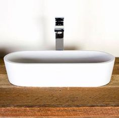 DADObaths - manufacturers of DADOquartz Stone Bathroomware - durable and uniquely crafted, freestanding stone baths, basins, taps, toilets and vanities.