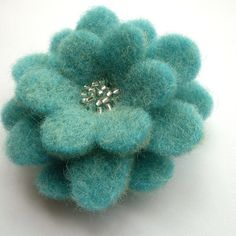 Pretty felted wool flower pin.(I put this on this board because it would like nice on a finished hat or sweater.)