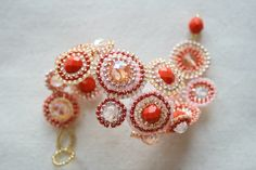 The Golden Sunset piece is made in warm taupe, orange and red shades, with sparkly seed beads in the center. Can be worn on its own or together with more bracelets.    For sale here  http://www.etsy.com/shop/dutchbeadworks?show_panel=true