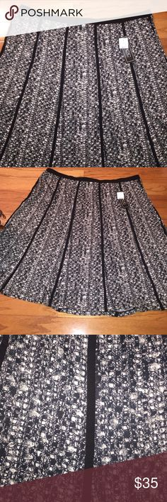 NYCC Printed Skirt This is a skirt that has a wonderful print with black seams throughout for definition and style. Waist 42 inches flat, hips 58 inches flat with a lot of stretch. Length 26 inches flat. Winterize this  skirt just by adding boots and tights!!!  NYCC Skirts Midi