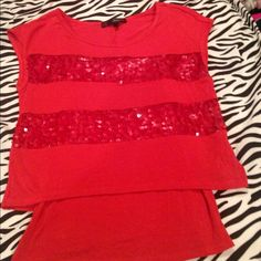Red sequin crop top with attached tank top Sz. XS Never worn but very pretty red crop top shirt with sequin strips and attached matching cami underneath! Fun & flirty I just can't seem to pull off red. Size XS but will also fit S. Heart and Soul Tops Tank Tops