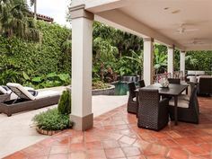 Backyard with pool and covered patio of luxury home in  Palm Beach, Florida