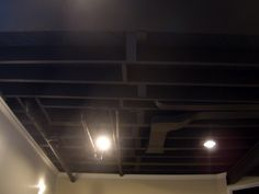 "Spray paint basement ceiling flat/matte black paint and update lighting. ""Finish the basement"" project number ##"