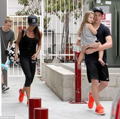 Victoria Beckham and son Brooklyn sport matching fluorescent trainers as they leave spin class with David and Harper   Mail Online
