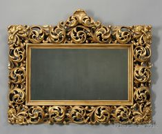 Italian Rococo-style Carved Giltwood Mirror, with shell-topped crest and framed by tight circular acanthus scrolls