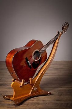 The Coeur d'Alene guitar stand is finely crafted using handpicked walnut and black cherry hardwoods. Combining the straight and figured grain structure of black Diy Guitar Stand, Wooden Guitar Stand, Guitar Display, Cool Guitar, Guitar Storage, Guitar Crafts, Guitar Wall Hanger, Rustic Bathroom Designs, Guitar Room
