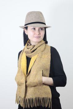 Fedora felt hat. Handmade in Kyrgyzstan. 100% wool. Band: suede. Felt scarf. Silk 30%, Wool 70%.Embedded pockets. Colours: Ocher, Sea Wave, Grey, Lilac, Brick Red, Blue.