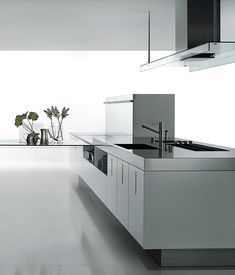 Luxury modern kitchen area by Boffi, stainless steel or high glossy finish _