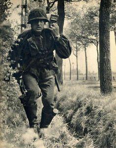 Waffen SS ammo runner. *note stick grenades in each boot.