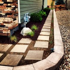 Side yard pathway using oversized poured pavers.