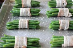 "Bacon Wrapped Green Bean Bundles - - Pretty little bundles of bacon wrapped French ""green beans"" known as Haricot verts which are longer and thinner than the typical American green beans. Of course, American green beans will work just fine here too. Bean Recipes, Side Dish Recipes, Vegetable Recipes, Ww Recipes, Recipies, Haricot Verts Recipe, Green Bean Bundles, Bacon Wrapped Green Beans, French Green Beans"