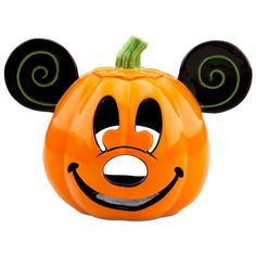 Brighten-up the darkest Halloween night with our Jack O'Lantern Mickey Mouse Votive Candle Holder. This smiling ceramic pumpkin with Mickey's familiar features will light the way for spooky fun as a Halloween party centerpiece.