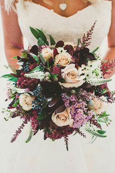 Love the textures and variety of flowers in this bouquet. I would love something like this but with a less fall-like colors. Maybe replace the darker reds with something lighter /brighter.