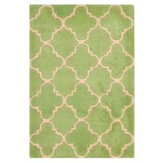 Bring stylish summer flair to your home décor with this beautifully hand-tufted wool rug, perfect for updating your den, dining room, or master suite.