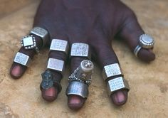 Africa | A collection of old rings, many of which are from the Tuareg people | silver