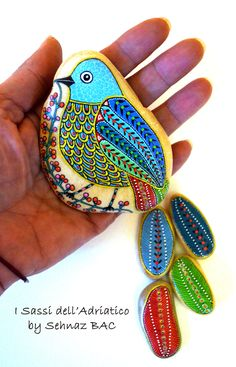 Working on a lot of new ideas My new #bird no 2015/1 is one of them with a long tail #paintedstones #isassidelladriatico