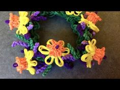 Rainbow Loom and Monster Tail - LAVENDER Bracelet with DAFFODIL Charms. ADVANCED. Designed and loomed by YarnJourney. Click photo for YouTube tutorial. 09/23/14.