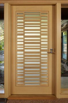 Glass and WoodThis custom door with a ladder-like glass and wood pattern is modern but also Japan-esque. You can bet that what's behind it is clean and simple.