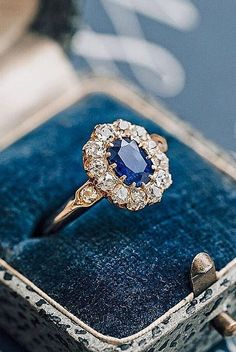 18 Best Vintage Engagement Rings For Romantic Look ❤ Best vintage engagement rings floral halo oval cut sapphire ❤ More on the blog: https://ohsoperfectproposal.com/best-vintage-engagement-rings/ #haloengagementring #vintagerings