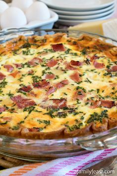 Ham and Swiss Quiche - A classic flavor combination in a quiche. Recipe includes the best quiche custard that can be used with any cheese, meats or veggies you'd like. Breakfast Quiche, Breakfast Dishes, Breakfast Time, Breakfast Recipes, Breakfast Casserole, Ham And Swiss Quiche, Ham And Cheese Quiche, Quiches, Omelettes