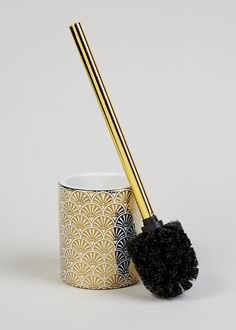 Bring a touch of art deco style to your bathroom with this toilet brush and holder, featuring a gold fan print to the body. Perfect for adding a metallic colour accent. Part of a co-ordinating set. Dimensions: Height x Diameter