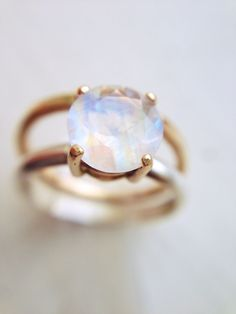 Moonstone Engagement Ring: A stunning round diamond cut, large 7 mm Rainbow Moonstone ring, with married metal design of 14K solid gold and recycled silver.