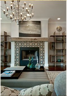 Tile around the fireplace and chandelier - the reclaimed wood, blues, greens