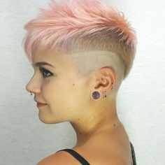 Who said you can't rock layers with an undercut? Add some extra dimension to your shaved style by rocking this layered look. Bonus points for achieving this cotton-candy-pink hue too.