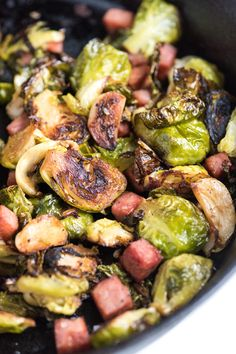 A simple roasted brussels sprouts recipe with garlic and ham. Learn our tricks for tender brussels sprouts that are perfectly caramelized and delicious. Garlic Recipes, Ham Recipes, Dinner Recipes, Cooking Recipes, Healthy Recipes, Dinner Ideas, Roast Recipes, Potato Recipes, Yummy Recipes