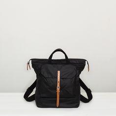 Ally Capellino | Waxed cotton rucksack in black | Ally Capellino