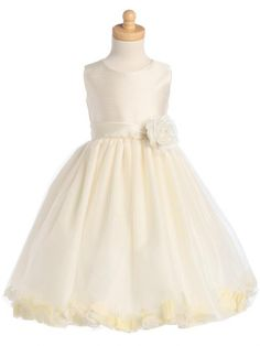 Ivory Tulle Flower Girl Dress  -  This flower girl dress is so versatile.  Tulle skirt with ivory petals is changeable!  Petals can be removed and you can leave the petals out or add petals in color to match your wedding party.  Elegant dress has ivory shantung bodice and sash with tulle skirt.  Pretty rose pin at sash is removable. The color is a true ivory.  The petals in the tulle are a combination of pink and ivory, with green leaves.