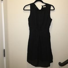 Black Spring Dress NWOT. Never worn. Purchased from Hautelook. Stretches it back to keep a fitted look. Sleeveless. Lightweight dress with sheer black overlay. Would be fantastic with heels and a blazer for a more professional feel or add some fun accessories for a night out! In Style Dresses Mini