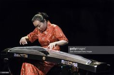 http://media.gettyimages.com/photos/chinese-musician-liu-fang-plays-a-pipa-during-the-world-music-music-picture-id165870804