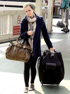 EXCESS BAGGAGE After announcing her plan to leave Brown University, Emma Watson gets things rolling at Heathrow Airport, catching a flight out of London on Sunday.